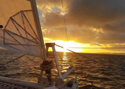 Image sunset on catamaran boat