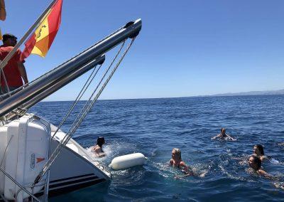 Bathing in the sea from boat in Benalmadena, Malaga-min