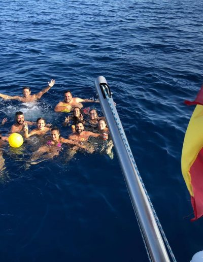 Enjoying a swim in the sea in our private boat trip in Malaga