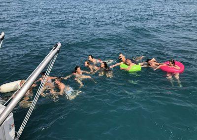 catamaran trip with friends and bath at sea in Benalmadena-min